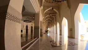 Imam Abdul Wahhab Mosque. Doha, Qatar - February 21, 2019: interior of atrium in Imam Abdul Wahhab Mosque with lit chandeliers. Qatar State Mosque in Middle East stock video