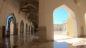 Imam Abdul Wahhab Mosque. Doha, Qatar - February 21, 2019: interior of Imam Abdul Wahhab Mosque with lit chandeliers. State Qatar Grand Mosque with decorated stock video footage