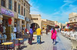 Walk in old streets of Souq Waqif, Doha, Qatar. DOHA, QATAR - FEBRUARY 13, 2018: The old streets of Souq Waqif are best place to enjoy historic architecture Royalty Free Stock Photos