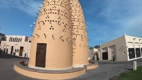 Pigeon Towers Katara Village. Doha, Qatar - February 17, 2019:tilt shift bottom up of the famous pigeon towers in front of Mosque in Katara, a cultural village stock video