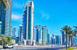 Urban scene, Doha, Qatar. DOHA, QATAR - FEBRUARY 13, 2018: The urban scene with skyscrapers of Al Dafna district in West Bay neighborhood, on February 13 in Doha stock photo