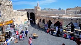 Activity in Birds Market, Doha, Qatar. DOHA, QATAR - FEBRUARY 13, 2018: The view from the roof on the daily activity in Birds market of restored Souq Waqif, on stock video footage