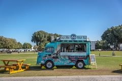 Doha, Qatar - Jan 9th 2018 - A food truck selling foods and beverages in a public park, green open area, in Doha, Qatar.  royalty free stock images