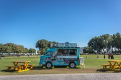 Doha, Qatar - Jan 9th 2018 - A food truck selling foods and beverages in a public park, green open area, in Doha, Qatar royalty free stock photo