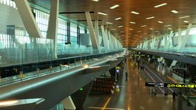 Doha, Qatar - 23 MAR, 2018 : Timelapse Airport Train Riding Between Terminals and Passengers walk through the Modern. Departure hall of Hamad International stock footage