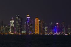Doha towers at night. DOHA, QATAR - NOVEMBER 11, 2017: Night view of the city`s towers during the diplomatic crisis Royalty Free Stock Image