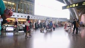 DOHA, QATAR, - OCTOBER 12, 2016: Terminal airport with passengers with bags. DOHA, QATAR, - OCTOBER 12, 2016 Terminal airport with passengers with bags stock video