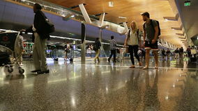 DOHA, QATAR, - OCTOBER 12, 2016: Terminal airport with passengers with bags. DOHA, QATAR, - OCTOBER 12, 2016 Terminal airport with passengers with bags stock footage