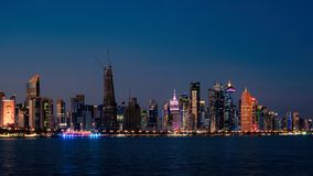 Doha Qatar skyline cityscape with skyscrapers at night royalty free stock photos