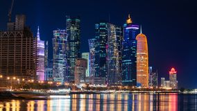 Doha Qatar skyline cityscape with skyscrapers at night royalty free stock image