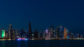 Doha Qatar skyline cityscape with skyscrapers at night stock photography