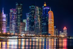 Doha Qatar skyline cityscape with skyscrapers at night royalty free stock photo