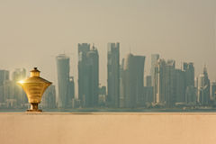 Doha quatar. Doha city skyline behind a beacon light reflecting sunshine Royalty Free Stock Image