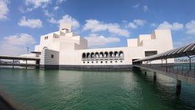 Doha Seafront Islamic Museum cloudy sky. Doha, Qatar - February 20, 2019: Museum of Islamic Art in Doha Bay, icon of urban cityscape. Qatari capital in Middle stock video