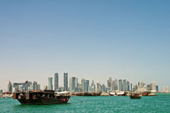 Doha skyline with dhows anchored Stock Photo
