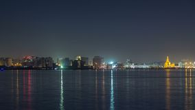 Doha skyline with the Islamic Cultural Center timelapse in Qatar, Middle East. Doha skyline with the Islamic Cultural Center timelapse illuminated by night in stock video footage