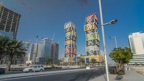 Doha skyline timelapse hyperlapse with colorful Al Marina Twin Towers building located the Lusail area of the capital of. Qatar. Palms and trees. Traffic on the stock footage