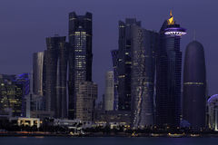 Doha skyscrapers at dusk Stock Images