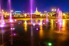 Doha water fountain night. Colorful water fountain at Souq Waqif Park at Doha Corniche with Fanar Islamic Cultural Center and Minaret at night on background stock photography