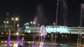 Doha water fountain night. Doha, Qatar - February 17, 2019: fountain at Souq Waqif Park at Doha Corniche. Doha center in Qatar, Middle East, Arabian Peninsula in stock video footage