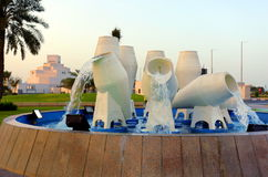 Doha waterpot fountain 2017. The repainted water-pot fountain beside Doha harbor and the Corniche road in Qatar, April 2017 Stock Photography