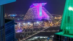 Doha West Bay view with hotel park night timelapse, Doha, Qatar, Middle East. Aerial top view. Traffic on the road stock footage