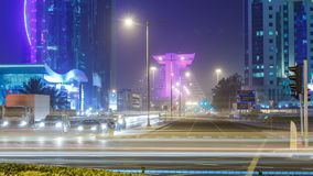Doha West Bay view near hotel park night timelapse, Doha, Qatar, Middle East. Traffic on the crossroad. Foggy weather stock footage