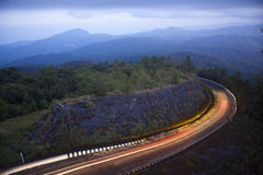 Doi Inthanon National park in the sunset. mist and main road in Stock Photo