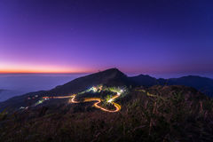 Doi Pha Tang. Mountains on a starry night and  road   Beautiful  mountain landscape Doi Pha Tang, Chiang Rai, Thailand Stock Photography