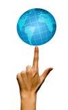 Doigt avec le globe Images libres de droits