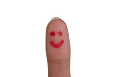 Doigt avec le sourire Photos libres de droits