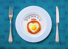 Doigt de calorie d'oeuf au plat photographie stock libre de droits