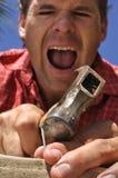 Doigt de marteaux de bricoleur Image libre de droits