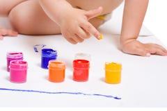 Doigt en peinture de couleur Photographie stock