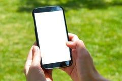 Doigt femelle de main touchant le téléphone intelligent Photos stock