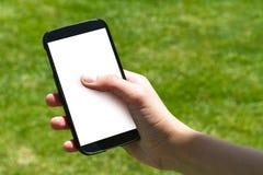 Doigt femelle de main touchant le téléphone intelligent Photo libre de droits