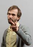 doigt poiting d'homme à l'appareil-photo Image stock