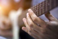 Doigt sur la guitare Image stock