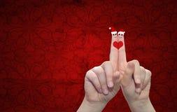 Doigts conceptuels de Noël dans l'amour Image stock