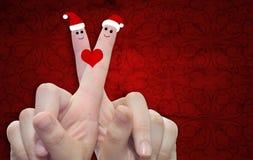 Doigts conceptuels de Noël dans l'amour Photographie stock