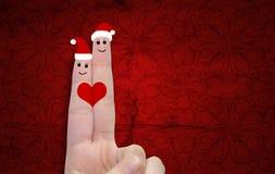 Doigts conceptuels de Noël dans l'amour Photo stock