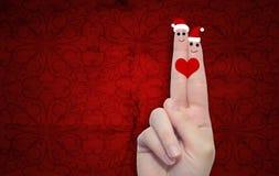 Doigts conceptuels de Noël dans l'amour Photo libre de droits