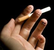 Doigts de fumage Images libres de droits