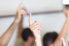 Doigts et mains dans la salle de classe Photographie stock libre de droits