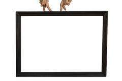 Doigts sur le cadre noir des textes Image stock