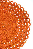 Doily arancione Handmade del crochet Fotografie Stock
