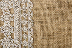 Doily on burlap. Half-covered burlap with handmade doily for backgrounds stock image