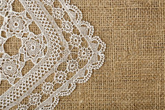 Doily on burlap Royalty Free Stock Images