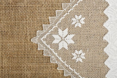 Doily and burlap Stock Images