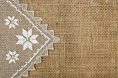 Doily and burlap. Half-covered burlap with handmade doily for backgrounds stock photo